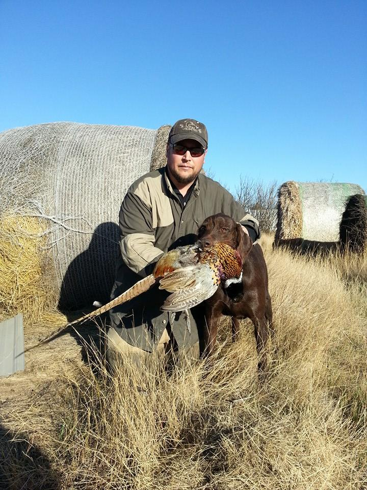 Todd Baier with a long-tailed rooster from 2014